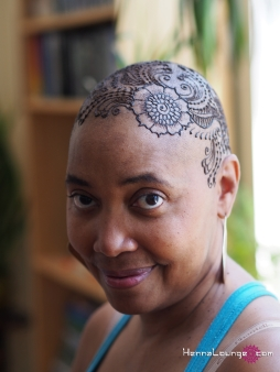 Beautiful, strong woman with henna crown