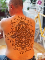 A flaming Hamsa for Burning Man