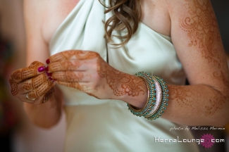 Ivory dress, chooria, and henna